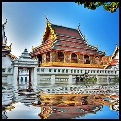 At the base of the Golden Mount . . (grantthai) Tags: lake reflections thailand temple gold golden flood bangkok squareformat thai pavilion wat goldenmount flooded watsaket 500x500 phukhaothong 35faves 25faves aplusphoto bratanesque
