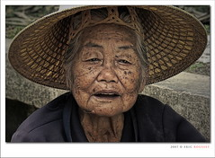 Grand Ma (Thailand) (Eric Rousset) Tags: voyage old travel grandma portrait people woman face hat lady photoshop thailand photography reflex bravo asia searchthebest cs2 bangkok quality sony femme thalande adobe chapeau asie soe photomanipulated visage 2007 theface postprocessing blueribbonwinner supershot magicdonkey outstandingshots passionphotography alpha100 sonydslra100 anawesomeshot ultimateshot megashot bratanesque amazingamateur thegoldenmermaid theroadtoheaven goldstaraward piproduction ostrellina ericrousset ericroussetphotography