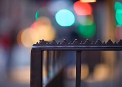 Serrated Railing (Richard-) Tags: newyork night raw bokeh wroughtiron bluenote 2007 lightroom canoneos5d canonef85mmf12liiusm bokehballs