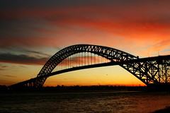 Bayonne Bridge (Manny Pabla) Tags: travel bridge sunset usa ny newyork america canon river evening bay us newjersey twilight dusk nj landmark historic statenisland tidal bayonne hudsoncounty route440 waterchannel bayonnebridge saini killvankull steelarchbridge mannysinghpabla