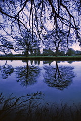 Reflections (Yvon from Ottawa) Tags: uk trees england 1969 35mm river nikon britain scanner slide calm scanned kodachrome avon warwickshire stratford refletion windless supercoolscan