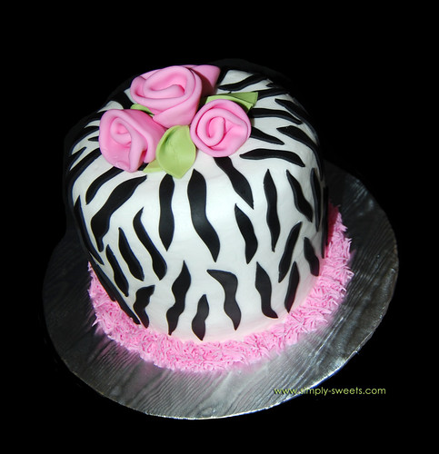 Zebra print cake with pink roses. Read more about our creations on the