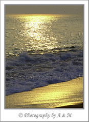 Golden Water (I Spy with my Idiosyncratic Eye ...) Tags: ocean sunset sea reflection beach water gold golden coast spring still waves dusk wave calm coastal lastlight photographybyaandm photographybyam
