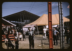 At the Vermont state fair, Rutland  (LOC) (The Library of Congress) Tags: carnival hammer kids children jack clothing vermont knickers statefair americanflag fair tent september cables libraryofcongress strength rutland midway forties 1941 ferias grandstand sunnyday delano fsa measurement countryfair ringthebell fsaowi rutlandvt jackdelano testyourstrength vermontstatefair agriculturefair xmlns:dc=httppurlorgdcelements11 rutlandcounty dc:identifier=httphdllocgovlocpnpfsac1a33906