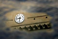 Water clock (six72) Tags: italy reflection clock water puddle italia tuscany toscana orologio greve riflesso pozzanghera eos400d six72