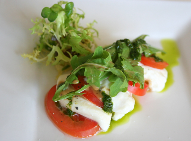 Tomato and mozzarella cheese salad with basil pesto
