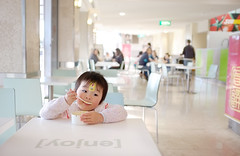 My 3 yo (nearly) daughter (zane&inzane) Tags: family portrait food children lunch bokeh eating daughter enjoy fujifilm foodcourt astia x100 mylovelydaughter