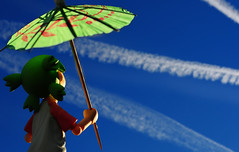 Blue sky with a chance of airplanes (revlimit) Tags: blue sky southwest toys saturated albuquerque explore 28 nikkor contrails yotsuba revoltech 55mm28macro nikond300 titlebysarah