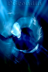 Over and over... (Phil Grondin) Tags: new blue original portrait night turn lost weird scary soft long exposure mask pentax ottawa performance dream twist falling flashlight bizarre turning lowshutter 360degree tralling