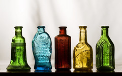 Wheaton Bottles (Jack of Nothing) Tags: old blue red green glass yellow newjersey bottle bottles nj souvenir worn weathered knickknacks libertybell wheaton millvillenj wheatonvillage stuhorvath averylongyear wheatonbottle wheatonglass chiefwahooelectrictonic millvillenewjersey