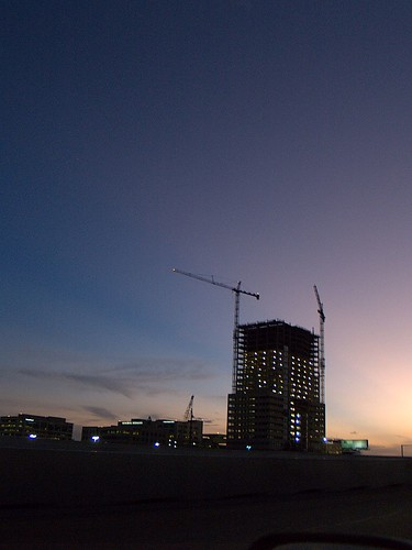Building and cranes at sunset