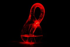 Klein bottle (procrastination) (Pragmagraphr) Tags: longexposure red stilllife lightpainting black science laser mathematics topology immersion kleinbottle manifold fourdimensional nikkor50mmf18d explored d80 nonorientable