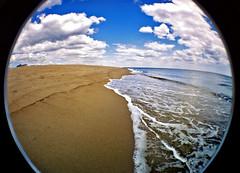 i miss summer (sandcastlematt) Tags: film beach clouds lomo lomography surf massachusetts fisheye newburyport plumisland bostonist lomofisheye fisheye2 universalhub lomofisheye2 imissthesummer ihatecoldweather takenbackinjune