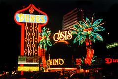 Dunes Hotel, Las Vegas, 1992 (StevenM_61) Tags: nightphotography usa sign lights hotel unitedstates lasvegas nevada casino 1992 demolished 1990s neonlighting