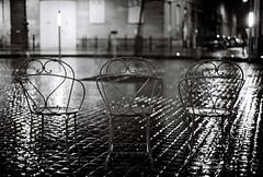 the directors (filtran) Tags: rain chairs kodak bordeaux pluie olympus zuiko 50mmf14 bw400cn om2n averse placemitchell kubrickslook bwart150308