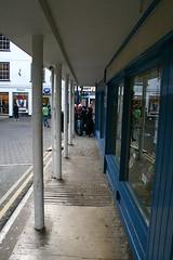 Abergavenny Covered Pavement (neil on a boat) Tags: road street blue reflection window lines tarmac yellow shop canon concrete eos pavement double sidewalk symmetrical posts pillars footpath abergavenny yfenni 400d