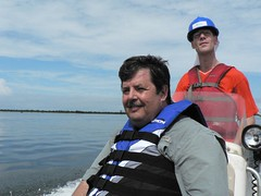 Rob and Obele in the Rescue Boat - taking it out for a spin after fixing the engine.