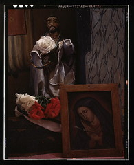 A Santo bulto and a painting of the Dolorosa i...