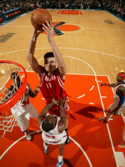 Yao Ming elevates to throw down a massive dunk over New York's Malik Rose on his way to scoring 36 points on 14-of-21 shooting, 7-of-8 from the line, and 11 rebounds to lead Houston to a 101-92 victory over the Knicks.