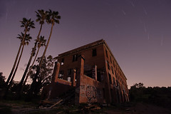sic transit gloria mundi - byron hot springs hotel (12019-12026) (ehoyer) Tags: longexposure trees sky hot 20d abandoned composite night canon hotel ruins structures wideangle palm palmtrees springs nightsky byron startrails polaris northstar canon1022mm byronhotsprings 8xp byronhotspringshotel sfchronicle96hrs