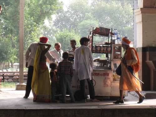 A sword-bearing Sikh walks past a chai stand at Jalandhar Junction train station in Punjab