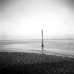 Where the sky meets the sea (mojo_black) Tags: sea mono coast holga lofi lancashire hp5 ilford fleetwood id1111