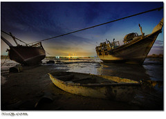 kuwait Beach Night shot with old boats (Eng.Nayef Alsolihem) Tags: sunset sea sky reflection beach boats boat nikon d70 sigma kuwait 1020 doha 2007     flickrsbest diamondclassphotographer flickrdiamond nssq8 nssq8com llovemypic worldwidelandscapes worldwidelandscapes