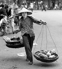 Hanoi 1997 (jonron239) Tags: street blackandwhite streets girl hat 645 pentax streetphotography vietnam 1997 hanoi streetvendor conical pentax645 conicalhat blackandwhitestreetphotography prefocus copyrightjohnphillips200820092010