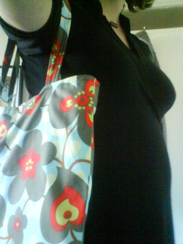 Bag, wrap dress and bump...