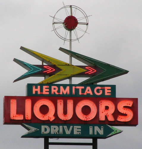 Hermitage Liquors sign - Illuminated cloudy version