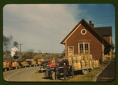 Trucks outside of a starch factory, Caribou, Aroostook County, Me. There were almost fifty trucks in the line. Some had been waiting for twenty-four hours for the potatoes to be graded and weighed  (LOC) (The Library of Congress) Tags: road red building industry me america truck jack potatoes traffic farmers barrels smoke telephone wheels 1940 maine overalls americans trucks libraryofcongress poles plaid caribou 20thcentury forties automobiles 40s delano fsa plaidshirt industrialization aroostook aroostookcounty cariboumaine waryears jackdelano xmlns:dc=httppurlorgdcelements11 dc:identifier=httphdllocgovlocpnpfsac1a33845 starchfactorys starchfactory hutshapedbuilding hutshaped