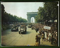 Crowds of French patriots line the Champs Elysees to view Allied tanks and half tracks pass through the Arc du Triomphe, after Paris was liberated on August 25, 1944  (LOC) (The Library of Congress) Tags: people paris france history de french army liberty freedom frankreich europe arch tank heart wwii crowd banner arc triomphe frana august victory slidefilm parade worldwarii 1940s triumph ww2 soldiers 4x5 lf libraryofcongress frankrijk cheer foule 25th guerre francia arcdetriomphe liberation largeformat 1944 frankrig pars halftrack arme  parigi victoire allies frankrike degaulle historique champslyses mmoire libration deuxiemeguerremondiale francja historicalphotographs ranska  franciaorszg  m3halftrack  xmlns:dc=httppurlorgdcelements11 hisoire dc:identifier=httphdllocgovlocpnpfsac1a55001 jackdowney vivedegaulle xxesiecle 75mmhowitzermotorcarriagem8 gnralleclerc 2medb rgimentdemarchedutchad