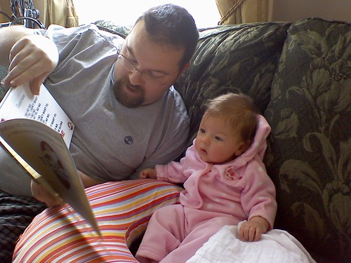 Eva and Daddy reading