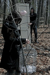 a hollow promise (Molls-Machine) Tags: door boy colour bird girl forest sticks woods cage highlights faded distractions