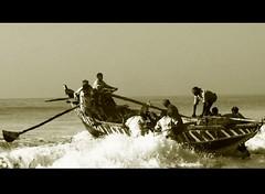 Struggle (Confused Shooter) Tags: sea blackandwhite india beach boat fisherman waves struggle puri oars