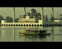 Serenity by the Crystal Mosque (Masjid Kristal) (Fadzly @ Shutterhack) Tags: travel vacation holiday hot reflection nature water sunrise d50 river catchycolors landscape asian golden boat interestingness nikon marine asia published zoom crystal natureza natur culture natuur fast natura mosque telephoto hour serenity malaysia tropical vista tropic serene passenger kuala paysage  masjid asean  kristal terengganu equator humid landschap publish mys    maleisi charakter  explored  sigmaapo70200mmf28exdghsm nikonstunninggallery kalikasan shutterhack pulauwanman tamantamaddunislam musabaqah