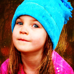 the kid in the hat comes back (DandelionSky) Tags: pink blue light portrait fall smile hat eyes child natural hannah magenta smirk