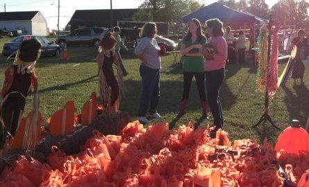 Sea of 200 orange Etsy swag bags