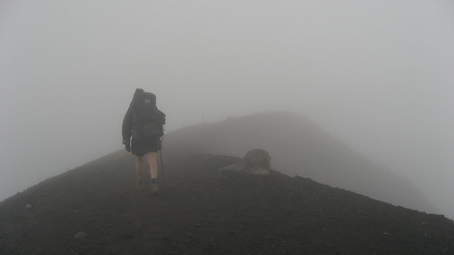 Walking the cloudy ridge line between two craters
