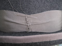 Hand stitched sideband, bow will go on top. Click to enlarge.
