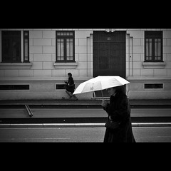 Rainy day (trazmumbalde) Tags: street people bw portugal rain umbrella walking pessoas europe running pb porto rua bwartaward