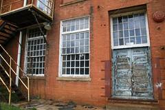 Backdoor (Doug Bradley Photography) Tags: door windows mill abandoned stairs rural georgia closed paint doors bricks chips textile callaway poison lead locked redbricks leadbasedpaint lockedout manchestergeorgia