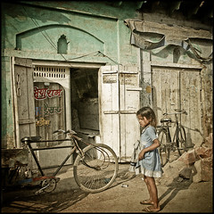 On the road (sistereden2) Tags: india triptych streetphotography bikes littlegirl masterphotographer 500x500 artlibre anawesomeshot 240x240 winner500 toppqualityimageonly