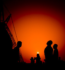 Admiring the Bird's Nest (Chee Seong) Tags: china sunset sun silhouette canon bravo stadium beijing olympic 2008 birdnest canon1022mm  beijingnationalstadium mynewphew 400d infinestyle