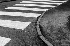 Zebra Crossing (Roj) Tags: originalphotographers conwy canon5dmkiv grain stripes pavement wales canonef40mmf28stm mono tarmac zebracrossing sourcerojsmithtumblrcom photographersontumblr uk gogleddcymru northwales bw blackandwhite monochrome