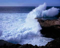The Devil's Tear, Nusa Lembongan (sixbysixtasy) Tags: ocean blue sea bali cliff film water indonesia island smash waves fuji spray velvia 6x7 roar nusa lembongan spume mamiya7ii