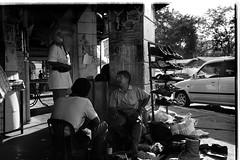 A Cobbler's Fix. (silentshutter) Tags: bw blackwhite streetphotography zeissikon cobbler mmount dyingtrade sgbesi biogont235zm enviromentalportraits