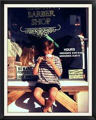 Boys Life (moonjazz) Tags: life california windows boy summer haircut signs ice childhood america bench dessert happy sitting afternoon eating humor navy young cream sidewalk nostalgia barber innocence shorts resting knees coronado pure boyhood pleasure spitting ordinary barberpole smalltowns pickpockets