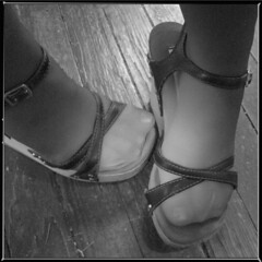 Black Shoes (mckenzieo) Tags: bw black sandals feminine platform shy grayscale strappy womensshoes womansfeet infraredandnaturallight