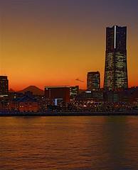 Landmark, Mt Fuji, and a very orange sunset (shinnygogo) Tags: city longexposure sunset urban orange japan horizontal skyline architecture skyscraper outdoors harbor pier twilight asia landmark  backlit yokohama majestic kanagawa mm21      hdr onthemove mtfuji oosanbashi       traveldestinations photomatix     yokohamalandmarktower        builtstructure nauticalvessel  landmarktowner